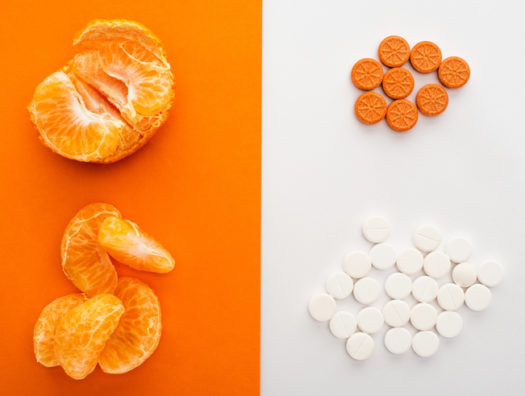 Dietary Supplements And Mandarin on White And Orange