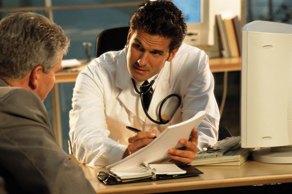 A middle-aged man at the doctor's getting the sexual performance treatment